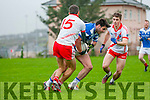 Annascaul James Crean in possession of the ball closely watched by Sean M. Ó Conchúir and Cathal Ó Lúing (An Ghaeltacht) during the West Kerry Final match at Pairc an Aghasaigh, Dingle, on Saturday afternoon.