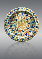 Hispano-Moresque ware dish with an eagle motif. Faience lustre ware, an islamic pottery style produced in Manises, Al Andalus, present day Spain in the second half of the 14th century.  inv 1438, The Louvre Museum, Paris.