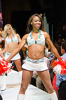 Miami Dolphins Cheerleaders Georgia and Natalie walk runway at Miami Dolphins Cheerleaders Swimsuit 2014 Calendar Unveiling and Fashion Show at Fontainebleau's LIV nightclub, Miami Beach, FL, September 5, 2013