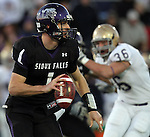 ROME, GA - DECEMBER 18: Quarterback Jon Eastman #1 of the University of Sioux Falls rolls out looking for a receiver against Carroll College in the second quarter at Barron Stadium in the 2010 NAIA National Football Championship in Rome, GA.(photo by Dave Eggen/Inertia)