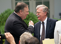 United States Secretary of State Mike Pompeo(L)and National Security Advisor John Bolton(R) chat before the start of a news briefing with Presidential United States President Donald J. Trump and Japanese Prime Minister Shinzo Abe at the White House in Washington, DC, June 7, 2018. <br /> CAP/MPI/RS<br /> &copy;RS/MPI/Capital Pictures