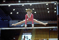 Oksana Omeliantchik of Soviet Union performs on uneven bars at 1985 European Championships in women's artistic gymnastics at Helsinki, Finland in late April, 1985.  Photo by Tom Theobald.