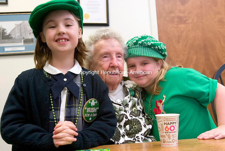 WINSTED, CT. 17 March 2010-031710SV01--Lorraine Tyrrell Hart sits with her great granddaughter, Elizabeth Klebe, 8, left, and her great great granddaughter Annalise Currier, 7, right during Mayor of the Day ceremonies in Winsted Wednesday. Hart was chosen to be this year's honorary mayor on St. Patrick's Day. She is 91 years old and is a commissioner at the Blanche McCarthy Winsted Senior Citizen Center. <br /> Steven Valenti Republican-American