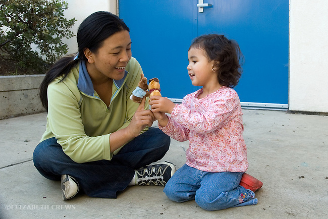 Berkeley CA Girl, two and a half, with Nepalese mother, communicating through hand puppet fantasy play  MR