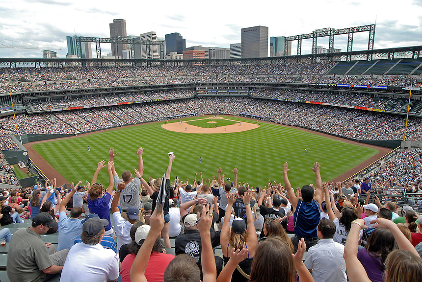 "08 June 2008: Rockies fans seated in the ""Rockpile"" bleacher seats take in the game with the Denver skyline visible during a regular season game between the Milwaukee Brewers and the Colorado Rockies at Coors Field in Denver, Colorado.*****For editorial use only*****"