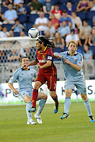 Real Salt Lake forward Fabian Espindola (7) wins the header against Sporting KC defender Seth Sinovic... Sporting Kansas City defeated Real Salt Lake 2-0 at LIVESTRONG Sporting Park, Kansas City, Kansas.