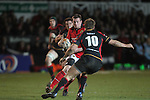 Denis Hurley takes on Lewis Robling..RaboDirect Pro12.Dragons v Munster.03.03.12.©STEVE POPE
