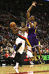 04/08/11--Portland Trailblazers' Wesley Matthews makes a lay-up by L.A. Lakers' Kobe Bryant in the first half at the Rose Garden..Photo by Jaime Valdez..........................................