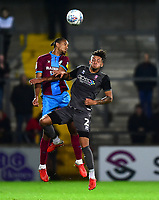 Lincoln City's Kellan Gordon vies for possession with  Scunthorpe United's Cameron Borthwick-Jackson<br /> <br /> Photographer Andrew Vaughan/CameraSport<br /> <br /> The EFL Checkatrade Trophy Northern Group H - Scunthorpe United v Lincoln City - Tuesday 9th October 2018 - Glanford Park - Scunthorpe<br />  <br /> World Copyright &copy; 2018 CameraSport. All rights reserved. 43 Linden Ave. Countesthorpe. Leicester. England. LE8 5PG - Tel: +44 (0) 116 277 4147 - admin@camerasport.com - www.camerasport.com
