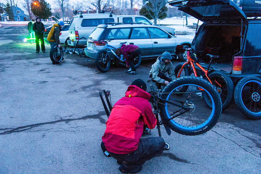 Prepping fat bikes for an early morning adventure ride on frozen Lake Superior in Marquette, Michigan.