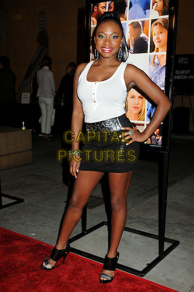 """NATURI NAUGHTON.""""Mother and Child"""" Los Angeles Premiere held at Grauman's Egyptian Theatre, Hollywood, California, USA..April 19th, 2010.full length white tank top silver grey gray mini skirt hand on hip.CAP/ADM/BP.©Byron Purvis/AdMedia/Capital Pictures."""
