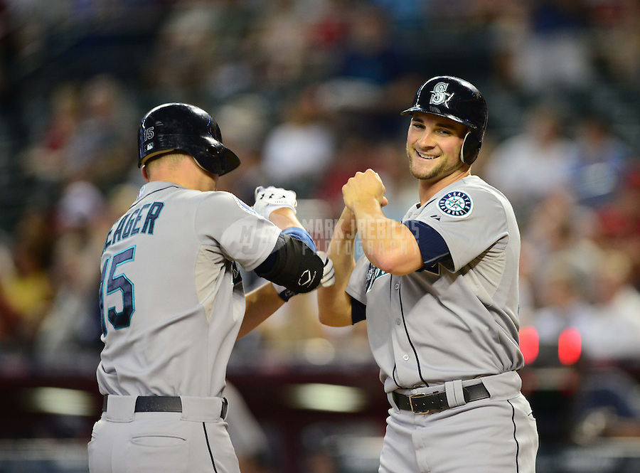 Jun. 20, 2012; Phoenix, AZ, USA; Seattle Mariners batter Kyle Seager (left) is congratulated by teammate Casper Wells after hitting a two run home run in the third inning against the Arizona Diamondbacks at Chase Field.  Mandatory Credit: Mark J. Rebilas-
