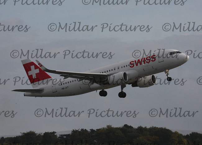 A Swiss Airbus A320-214 Registration HB-JLT bound for Zurich Airport taking off at Manchester Airport on 17.10.13.