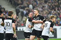 Ryan Crotty of New Zealand (second right) celebrates his try after a grubber kick through from Sonny Bill Williams of New Zealand (right) during the test match between France and New Zealand at Stade de France on November 11, 2017 in Paris, France. (Photo by Dave Winter/Icon Sport)