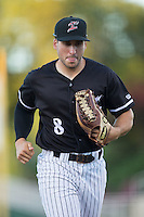 Kannapolis Intimidators right fielder Kyle Ruchim (8) jogs off the field between innings of the game against the Greenville Drive at Intimidators Stadium on June 7, 2016 in Kannapolis, North Carolina.  The Drive defeated the Intimidators 5-2 in game two of a double header.  (Brian Westerholt/Four Seam Images)