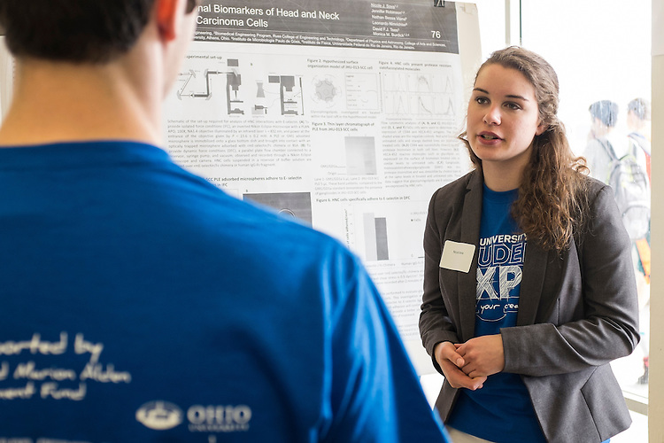 Nicole Sova, a junior Chemical Engineering major in the Russ College of Engineering and Technology, discusses her research with a fellow presenter during the Ohio University Student Expo on Thursday, April 10, 2015.  Siva was the recipient of Student Enhancement Award to help fund her research.  Photo by Ohio University  /  Rob Hardin