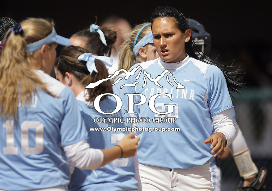 23 May 2010:  University of North Carolina pitcher Danielle Spaulding high fives teammates before the game against Washington.  Washington defeated the University of North Carolina 2-1 in eight innings at Husky Softball Stadium in Seattle, WA to advance in the NCAA regional tournament.