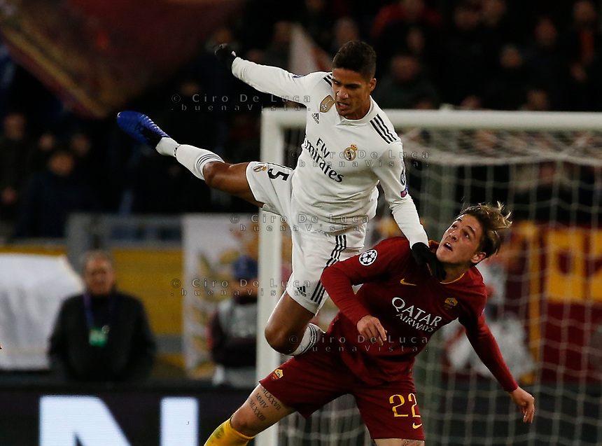 Raphael Varane of Real Madrid and Nicolo Zaniolo of AS Roma  during the Champions League Group  soccer match between AS Roma - Real Madrid  at the Stadio Olimpico in Rome Italy 27 November 2018