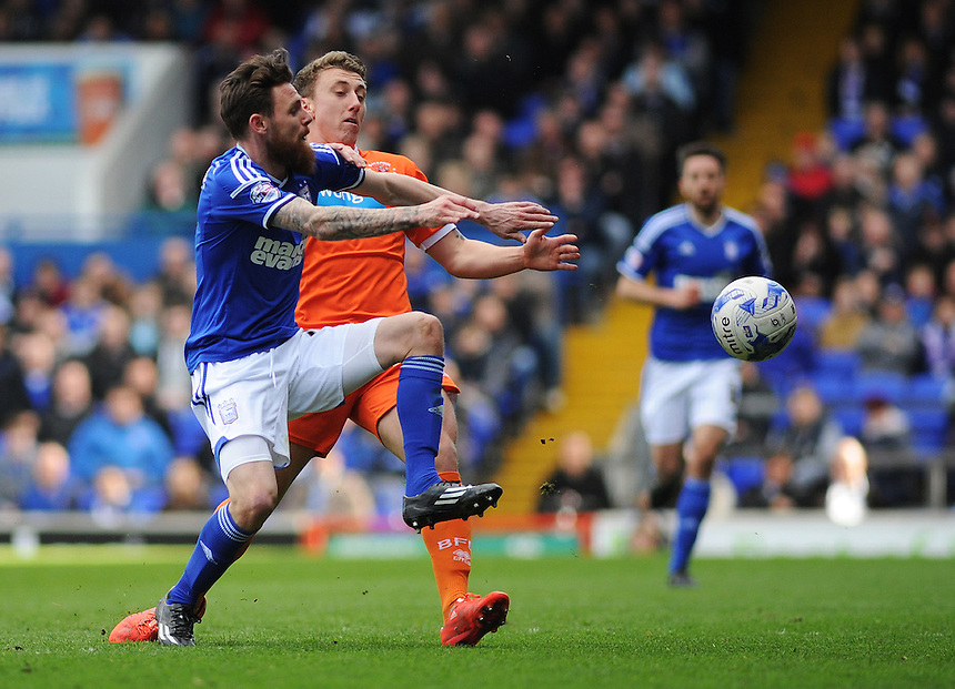 Blackpool's David Ferguson vies for possession with Ipswich Town's Paul Anderson<br /> <br /> Photographer Kevin Barnes/CameraSport<br /> <br /> Football - The Football League Sky Bet Championship - Ipswich Town v  Blackpool - Saturday 11th April 2015 - Portman Road - Ipswich<br /> <br /> &copy; CameraSport - 43 Linden Ave. Countesthorpe. Leicester. England. LE8 5PG - Tel: +44 (0) 116 277 4147 - admin@camerasport.com - www.camerasport.com