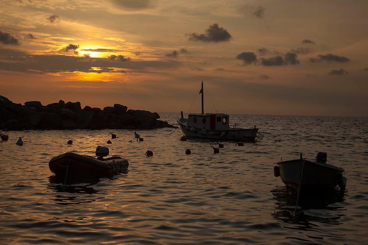 Sunset at Riomaggiore's harbor on the northern Italian coast