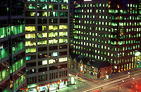 Canada, Ontario, Toronto. evening scene of office towers and traffic at intersection