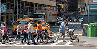 "Pedestrians cross Broadway at West 96th Street in New York on Monday, August 4, 2014. As part of Mayor Bill de Blasio's ""Vision Zero"" initiative the speed limit of 30 mph has been reduced to 25 mph. Broadway from West 59th Street to West 220 Street has been posted as a ""Slow Zone"". with the other ""Slow Zone"" starting today atSouthern Blvd. in the Bronx. Two dozen zones will be instituted in the five boroughs over the course of several months. 22 pedestrians have been killed since 2008 in the Broadway ""Slow Zone"" and speeding is the top cause of traffic injuries and fatalities.   (© Richard B. Levine)"