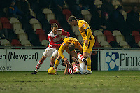 Dan Butler of Newport County clashes with John Marquis of Doncaster Rovers with Matty Blair of Doncaster Rovers and Darren Jones of Newport County also in attendance during the Sky Bet League 2 match between Newport County and Doncaster Rovers at Rodney Parade, Newport, Wales on 10 February 2017. Photo by Mark  Hawkins / PRiME Media Images.