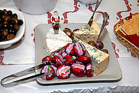 Assorted cheeses olives and crackers. Swedish Julbord at the American Swedish Institute Minneapolis Minnesota USA