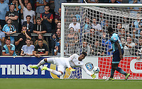 Goalkeeper Jamal Blackman of Wycombe Wanderers pulls off a save during the Sky Bet League 2 match between Wycombe Wanderers and Colchester United at Adams Park, High Wycombe, England on 27 August 2016. Photo by Andy Rowland.