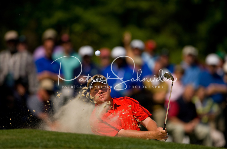 PGA golfer Carl Pettersson hits from a sand trap during the 2008 Wachovia Championships at Quail Hollow Country Club in Charlotte, NC.