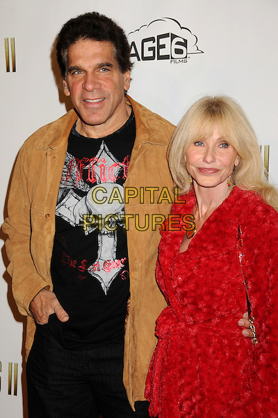 """LOU FERRIGNO & CARLA.""""The Boondock Saints II: All Saints Day"""" Los Angeles Premiere held at Arclight Cinemas, Hollywood, California, USA..October 28th, 2009.half length top jacket red dress married husband wife jacket floral print  black brown suede .CAP/ADM/BP.©Byron Purvis/AdMedia/Capital Pictures."""