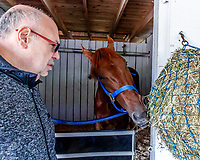 LOUISVILLE, KENTUCKY - MAY 02: Majority owner Salomón Del Valle with Gunnevera in his stall at Churchill Downs on May 2, 2017 in Louisville, Kentucky. (Photo by Jesse Caris/Eclipse Sportswire/Getty Images)