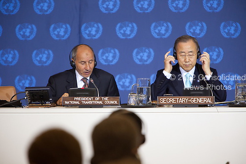 Chairman Mustafa Abdel Jalil of the Libyan Transitional National Council (TNC), left, makes remarks as United Nations Secretary-General Ban Ki-Moon, right, listens at a meeting of the Libya Contact Group at the UN in New York, New York on Tuesday, September 20, 2011..Credit: Allan Tannenbaum / Pool via CNP