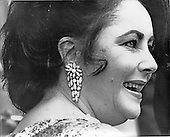 """Actress Elizabeth Taylor, wife of former United States Navy Secretary John Warner, works a receiving line at the Wolftrap Center for the Performing Arts in Vienna, Virginia on May 31, 1978. Ms. Taylor was chairman of the annual benefit dinner and show..Credit: Benjamin E. """"Gene"""" Forte / CNP"""