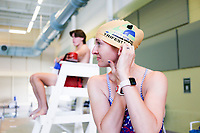 Hailey Venter of Bentonvile puts on a swimming cap, Monday, May 18, 2020 at the Bentonville Community Center in Bentonville. Community Center staff opened the pool for members 16 and older and for lap swimming only Monday. Members interested in swimming were required to register for an appointment in advance. Check out nwaonline.com/200519Daily/ for today's photo gallery.<br />