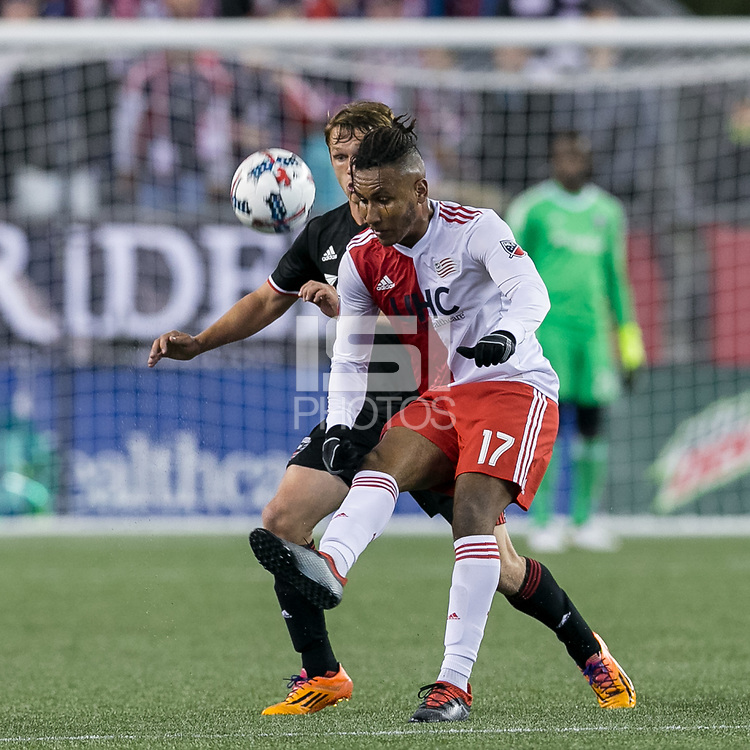 Foxborough, Massachusetts - April 22, 2017: First half action. In a Major League Soccer (MLS) match, New England Revolution (red/white) vs D.C. United (black), at Gillette Stadium.