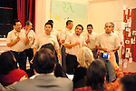 Guatemala laborers sing at a fund raiser for Neighbors Link, a non-profit group that provides hiring assistance and social services to the men.