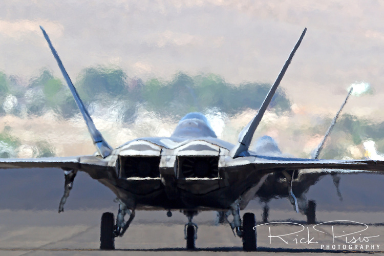 Exhaust heat generated by the Pratt & Whitney F119 turbofans distort the surrounding air. The F-22 Raptor first entered service in 2005 after 20 years of development. In December of 2011 the 195th, and final, F-22 Raptor rolled off the Lockheed assembly line.
