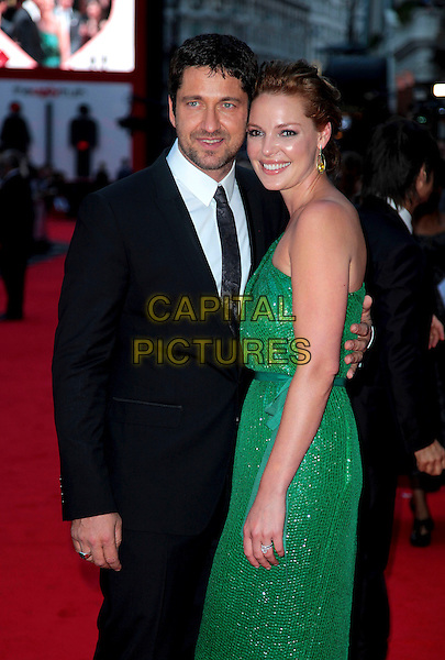 "GERARD BUTLER & KATHERINE HEIGL .At the UK Film Premiere of ""The Ugly Truth"" at  held at the Vue West End, Leicester Square, London, England, UK, August 4th 2009..half length one shoulder green dress  sparkly sequined shiny black suit tie arm around .CAP/CAS.©Bob Cass/Capital Pictures"
