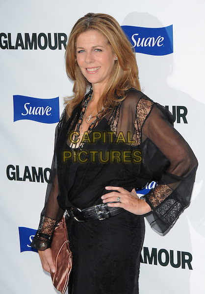 RITA WILSON.The Glamour Reel Moments held at The DGA in West Hollywood, California, USA. .October 14th, 2008                                                                     .half length black dress sheer sleeves pink clutch bag hand on hip belt.CAP/DVS.©Debbie VanStory/Capital Pictures.
