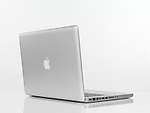 Macbook Pro laptop computer rear view with Apple logo on the lid isolated on white background