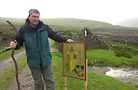 CLONFERT TO BRANDON PILGRIMMAGE 16-5-00<br /> Fr. Tomas O'Caoimh, pictured  at the foot of mist covered Brandon Mountain in Co. Kerry after the pilgrimmage from Clonfert to Brandon was called off  due to inclement weather.  The icon of St. Brendan was due to be dedicated to the Kerry saint on the anniversary of the saint's birth .The icon was written by Sr. Aloysius McVeigh of Derry.<br /> Picture by Don MacMonagle