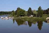 Porvoonjoki river.<br /> Il fiume Porvoonjoki.<br /> Porvoo Borgå è un'antica città medievale dichiarata dall'UNESCO patrimonio dell'umanità.<br /> Porvoo Borgå is an old medieval town, UNESCO World Heritage Site.