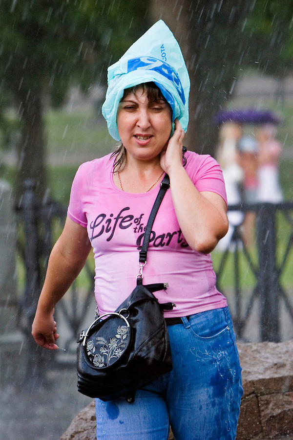 Moscow, Russia, 09/07/2006..People on Manezh Square by the Kremlin run for cover during a sudden summer thunderstorm.