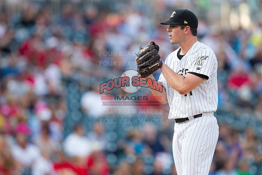 Charlotte Knights starting pitcher Carlos Rodon (41) looks to his catcher for the sign against the Gwinnett Braves at BB&T Ballpark on August 19, 2014 in Charlotte, North Carolina.  The Braves defeated the Knights 10-5.   (Brian Westerholt/Four Seam Images)
