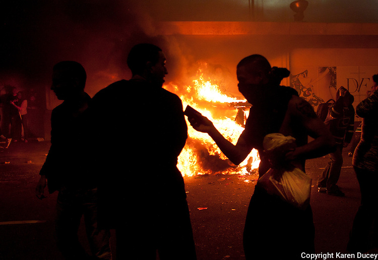 Rioters loot stores and burn cars on the downtown streets of Vancouver,BC after the Canucks were defeated by the Boston Bruins in the Stanly Cup on June 15, 2011. (photo copyright Karen Ducey)