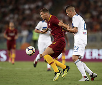 Calcio, Serie A: Roma - Atalanta, Stadio Olimpico, 27 agosto, 2018.<br /> Roma's Edin Dzeko (l) in action with Atalanta's Gianluca Mancini (r) during the Italian Serie A football match between Roma and Atalanta at Roma's Stadio Olimpico, August 27, 2018.<br /> UPDATE IMAGES PRESS/Isabella Bonotto