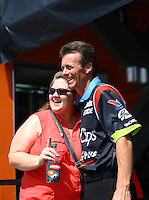Apr 25, 2015; Baytown, TX, USA; NHRA top fuel driver Clay Millican poses for photo with a fan during qualifying for the Spring Nationals at Royal Purple Raceway. Mandatory Credit: Mark J. Rebilas-