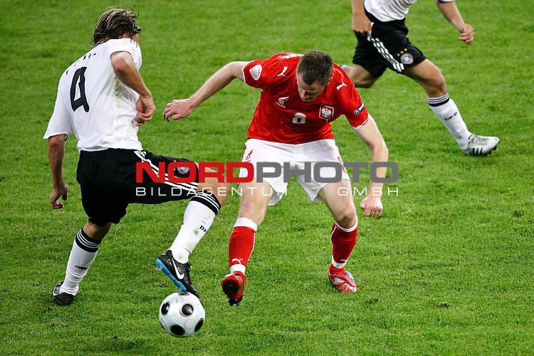 UEFA Euro 2008 Group B Klagenfurt - W&ouml;rthersee Match 04 <br /> <br /> Deutschland ( GER ) - Polen ( POL )<br /> <br /> Zweikampf zwischen Clemens Fritz ( Germany / Mittelfeldspieler / Midfielder /  Werder Bremen #4) gegen Jacek Krzynowek  ( Poland / Mittelfeldspieler / Midfielder / VfL Wolfsburg #08 )<br /> <br /> <br /> Foto &copy; nph (  nordphoto  )<br /> <br /> <br /> <br />  *** Local Caption ***