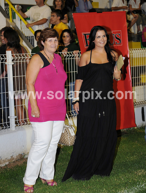**ALL ROUND PICTURES FROM SOLARPIX.COM**.**WORLDWIDE SYNDICATION RIGHTS**.Although Cristiano Ronaldo was expected to be a guest at the Julio Iglesias  concert in Portimao, Algarve, Portugal, it was his family who made the star appearance, led by his mother Dolores (in the purple dress) and his sister Katia Aveiro (black dress). 5th August 2008..JOB REF: 6972 PPL        DATE: 05_08_2008.**MUST CREDIT SOLARPIX.COM OR DOUBLE FEE WILL BE CHARGED* *UNDER NO CIRCUMSTANCES IS THIS IMAGE TO BE REPRODUCED FOR ANY ONLINE EDITION WITHOUT PRIOR PERMISSION*